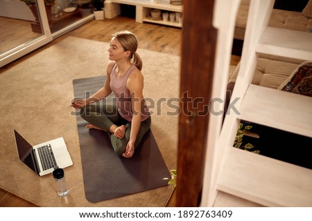 Stock photo: High angle view of people meditating in prayer position at club