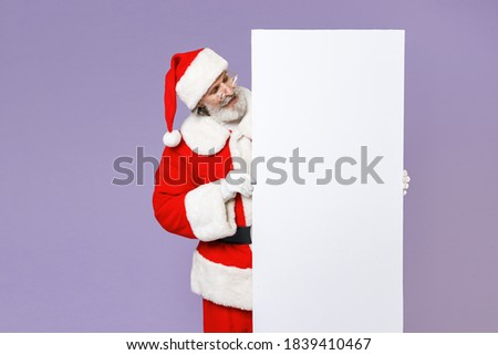 Santa Claus holding banner blank. Christmas grandfather and whit Stock photo © popaukropa