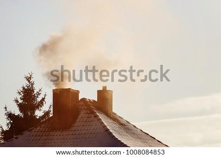 белый дым дома дымоход зима ночное небо Сток-фото © vapi