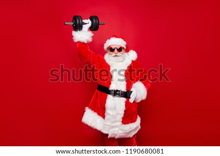 Strong Santa Claus. Santa with big muscles. Old bodybuilder with Stock photo © popaukropa