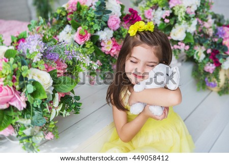 cute little girl hugging rabbit and looking at basket with easter eggs in nest Stock photo © LightFieldStudios