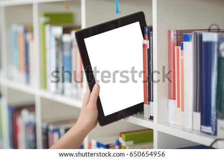 Stock photo: Hand of student keeping digital tablet in bookshelf in library at school
