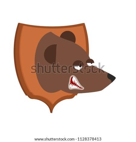Bear hunter trophy. Grizzly head on shield. Scarecrow wild beast Stock photo © popaukropa