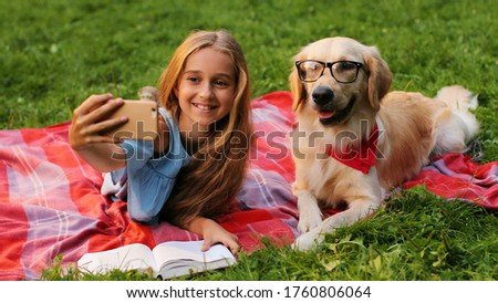 Cute girl with her adorable labrador puppy dogs at the