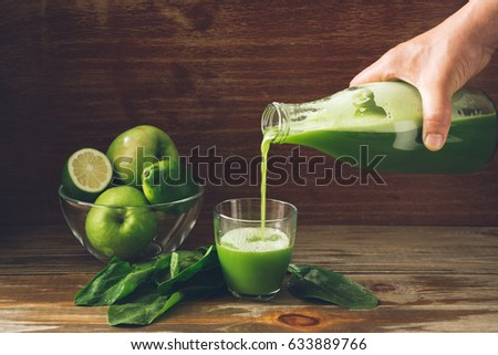 Glass bottle of fresh smoothie juice organic green toned fruit a stock photo © DenisMArt