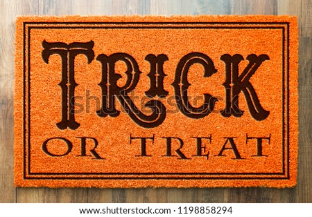 Trick Or Treat Halloween Orange Welcome Mat On Wood Floor Backgr Stock photo © feverpitch