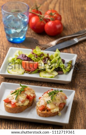 Homemade fresh figs salad with herbs and roasted garlic toast Stock photo © Peteer