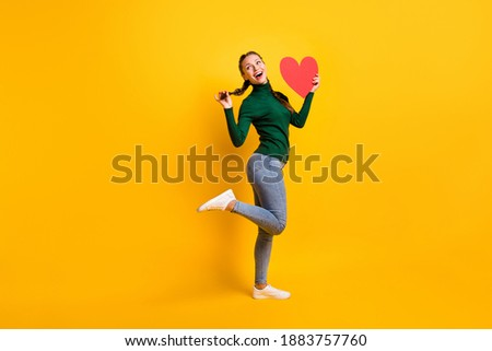 Girl with red pigtails on a yellow background. A charming girl in round transparent glasses screams  Stock photo © Traimak