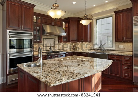 Kitchen interior with cherry wood dining room table and orange tone cabinets in large room. Stock photo © iriana88w