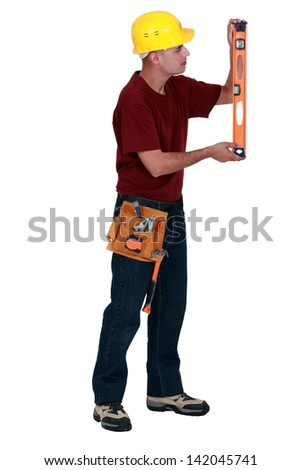 Caucasian Male Contractor With Hard Hat, Level and Safety Vest I Stock photo © feverpitch