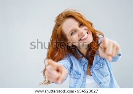 image of two positive girls smiling and pointing fingers aside t stock photo © deandrobot