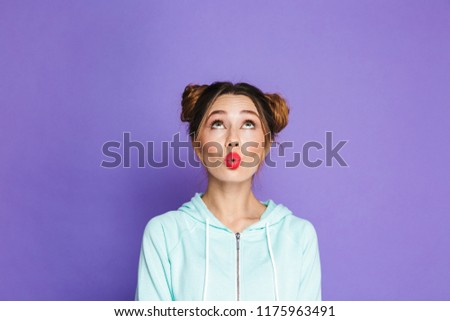 Portrait of glamour woman with two buns looking upward on copysp Stock photo © deandrobot