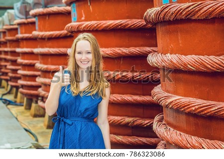 Stock photo: young woman traveler show how they like fish sauce on Phu Quoc, Vietnam