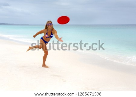 aussie girl playing frisbee on idyllic beach beach culture fitness stock photo © lovleah