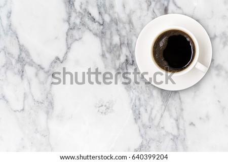 Siyah kahve fincan fincan tabağı siyah taş mutfak masası Stok fotoğraf © DenisMArt