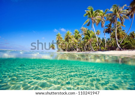 Beautiful atoll, sunny tropical scenery, islands, beach with white sand and lagoon Stock photo © galitskaya