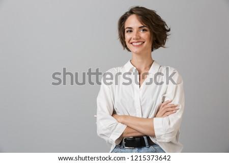 Mulher de negócios posando isolado cinza parede potável Foto stock © deandrobot