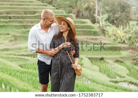 Young man traveler on Beautiful Jatiluwih Rice Terraces against the background of famous volcanoes i Stock photo © galitskaya