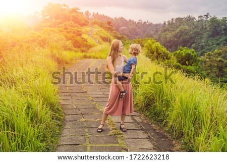 mom and son tourists in campuhan ridge walk scenic green valley in ubud bali traveling with child stock photo © galitskaya