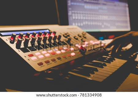 hand mixing music on midi controller with play music and multime stock photo © ra2studio