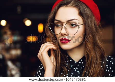 portrait inside a beautiful young woman with bright makeup pink nail polish and pink lipstick on t stock photo © studiolucky