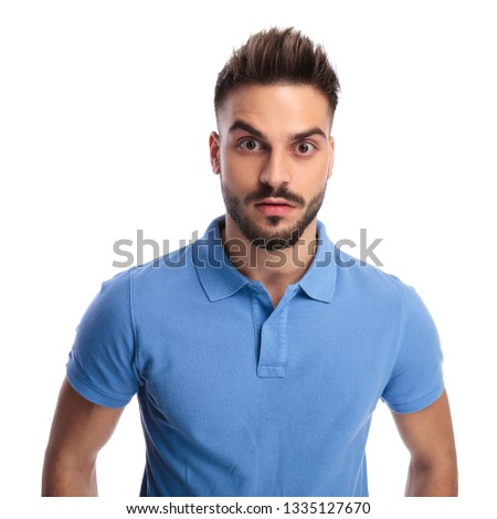 Casually-dressed youngster wearing a light blue polo being surpr Stock photo © feedough