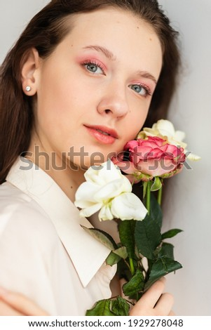 Young girl with red hair holds beautiful bunch of roses living coral colored. Close-up. Conept of ce Stock photo © artjazz