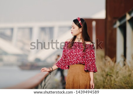 Stock photo: Image of cheerful happy woman 20s in hair band smiling and showi