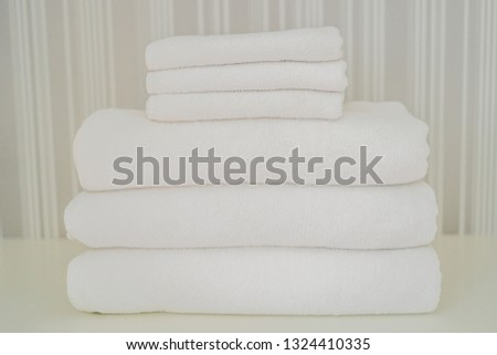 A pile of white fluffy towels in the closet. Service in the hotel concept. laundry stock photo © galitskaya
