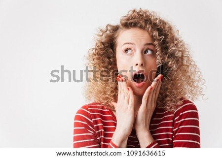 Shocked blonde curly woman in casual clothes touching her cheeks Stock photo © deandrobot