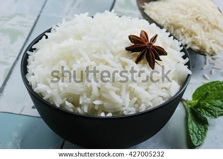 Black bowl of raw organic basmati rice on white background. Healthy food.  stock photo © DenisMArt