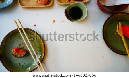 Messy table after meal in Japanese restaurant. Dirty, finish meal, leftovers concepts VERTICAL FORMA Stock photo © galitskaya