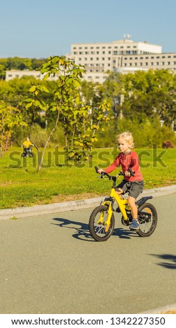 Stock photo: Two happy boys cycling in the park VERTICAL FORMAT for Instagram mobile story or stories size. Mobil