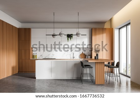 Interior of kitchen in large and comfortable apartment or cottage Stock photo © pressmaster