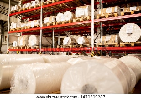Rows of rolled and packed newly produced huge bobbins of polyethylene membrane Stock photo © pressmaster