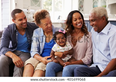 Front view of happy multi-generation family looking each other on beach in the sunshine Stock photo © wavebreak_media