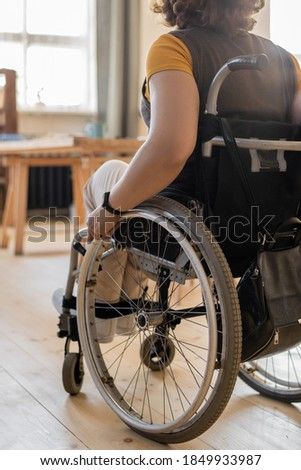 front view of young female doctor helping disabled senior woman in garden on sunny day stock photo © wavebreak_media