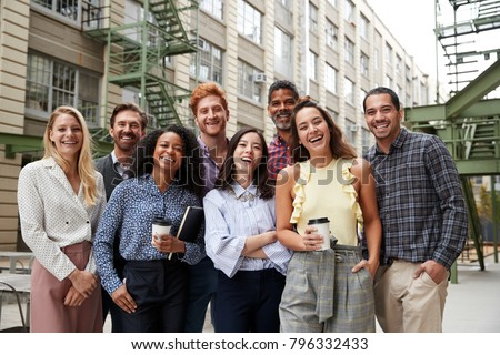 front view of diverse business colleagues laughing and interacting with each other in modern office stock photo © wavebreak_media