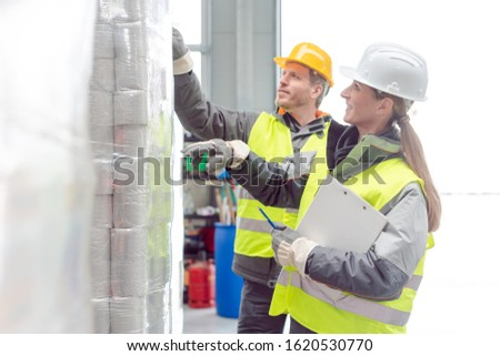 Workers in the rental toilet business checking the paper stock Stock photo © Kzenon