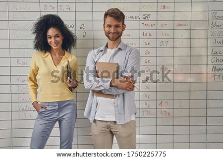 Front view of pretty Caucasian businesswoman and handsome African American businessman signing in at Stock photo © wavebreak_media