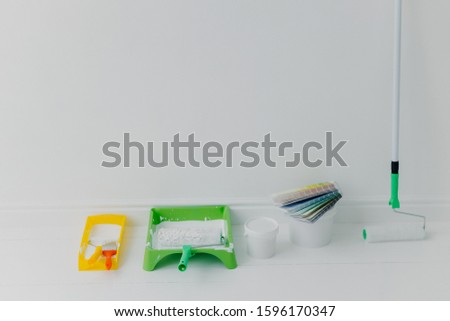 House renovation and accessories against white background. Set of paint tools with color samples. Pa Stock photo © vkstudio