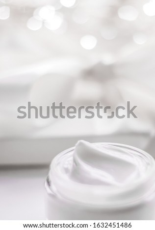 Facial cream moisturizer jar on holiday glitter background, mois Stock photo © Anneleven