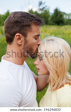 Outdoor portrait of lovely affectionate couple embracing each ot Stock photo © vkstudio