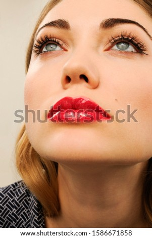 Vertical shot of thoughtful red haired woman with make up, takes rest on chair, wears black sweatshi Stock photo © vkstudio