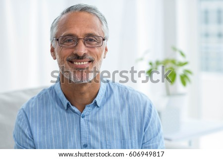 Front view of matured confident Caucasian  male doctor examining senior African-american  woman with Stock photo © wavebreak_media
