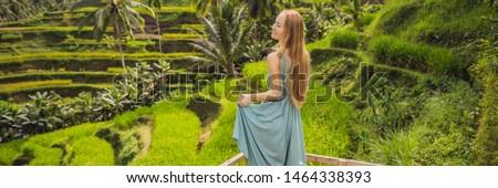 BANNER, LONG FORMAT Beautiful young woman walk at typical Asian hillside with rice farming, mountain Stock photo © galitskaya