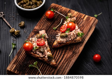 Banner of Appetizer bruschetta with tuna and tomatoes. Italian cuisine. Stock photo © Illia