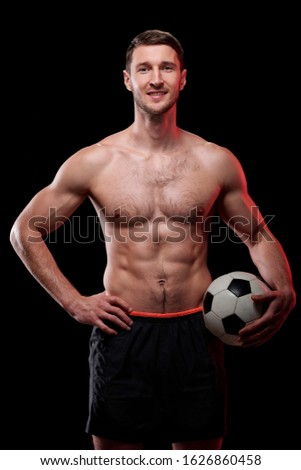Happy muscular shirtless footballer with ball standing in front of camera Stock photo © pressmaster