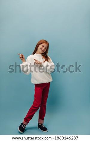 Pequeno adorável feminino criança branco suéter Foto stock © vkstudio
