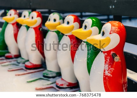 Horizontal shot of colorful skate aids in shape of funny penguins, needed to keep balance on ice rin Stock photo © vkstudio